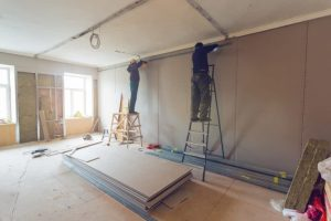 Hang drywall and install trim